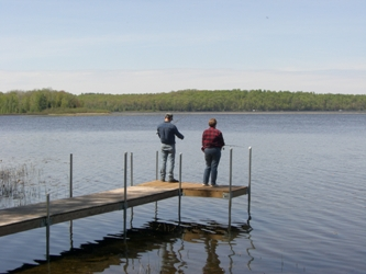 Fishing off the end of the dock at The Cottage on Big Sand Lake